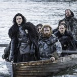 """This image released by HBO shows Kit Harington as Jon Snow, left, in a scene from """"Game of Thrones."""" The series was nominated for an Emmy Award on Thursday, July 16, 2015, for outstanding drama series. The 67th Annual Primetime Emmy Awards will take place on Sept. 20, 2015. (Helen Sloan/HBO via AP)"""