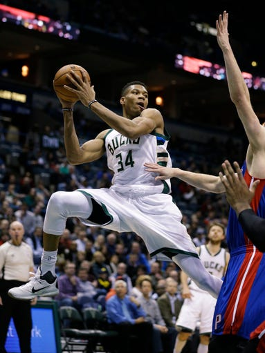 Milwaukee Bucks' Giannis Antetokounmpo looks to pass