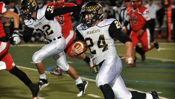 Henrietta quarterback Zack West (24) rushed and passed