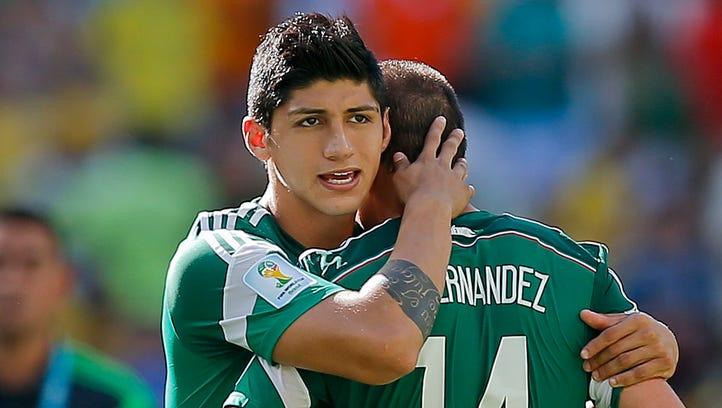 Mexico's Alan Pulido consoles teammate Javier Hernandez