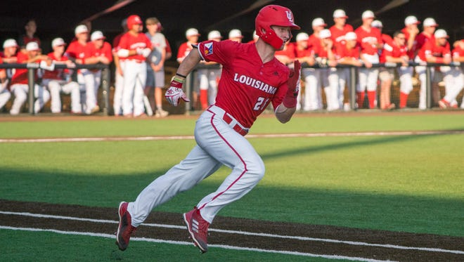 UL's Daniel Lahare runs to first base as the Ragin' Cajuns take on the UL Monroe Warhawks at M.L. Tigue Moore Field May 18, 2018.