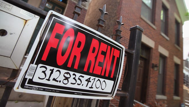 """A """"For Rent"""" sign stands in front of a house in Chicago."""