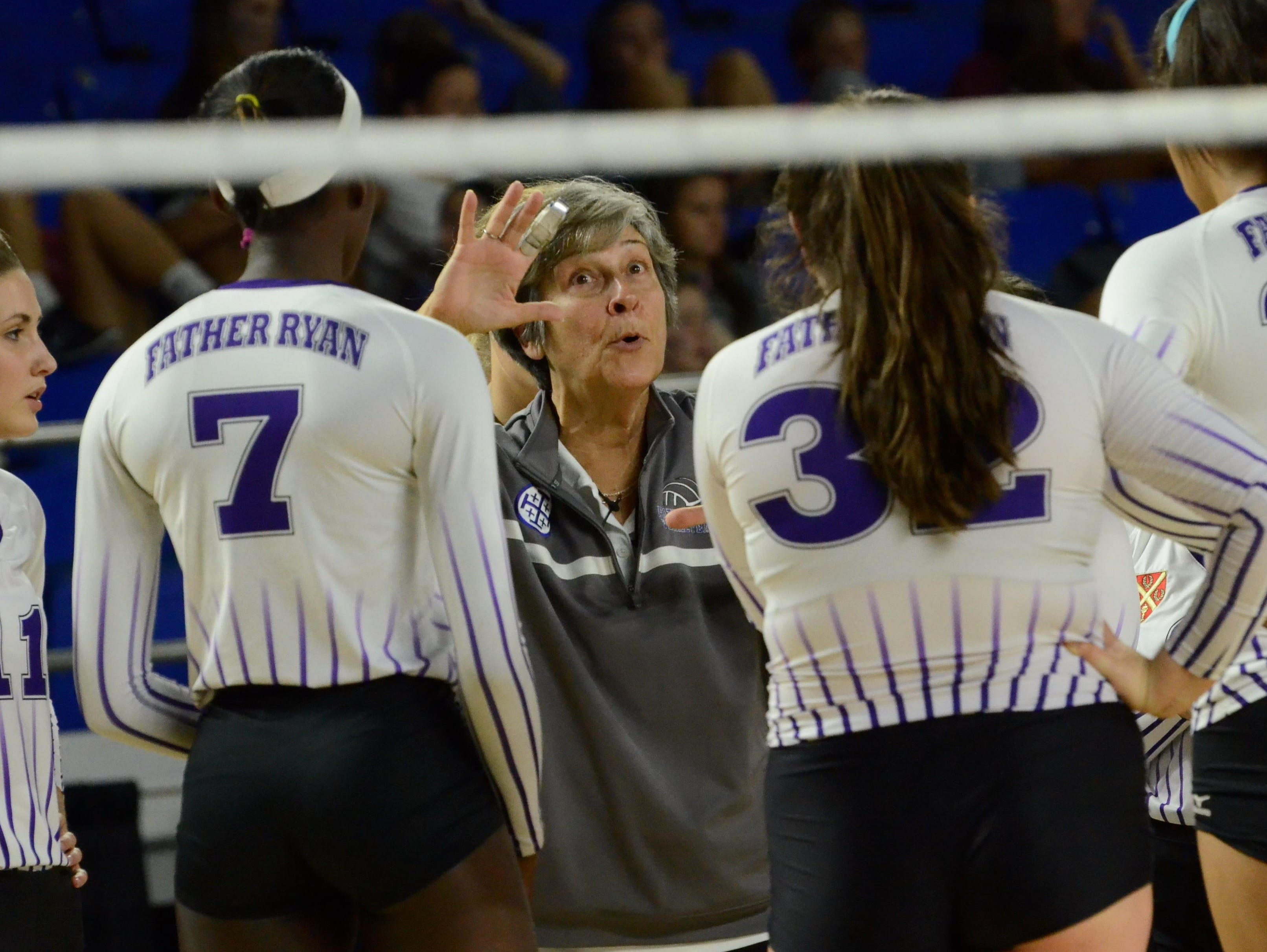 Father Ryan coach Jinx Cockerham talks to her team in a timeout during Thursday's winner's bracket final against Baylor at MTSU's Murphy Center.