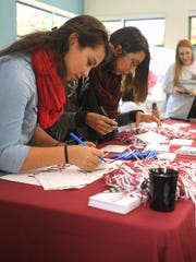 12/01/2015: Left to right: Student volunteers Cynthia Nunez and Tannya Barba write thank you notes to donors during the Giving Tuesday fundraising event at the NMSU Corbett Center Student Union.