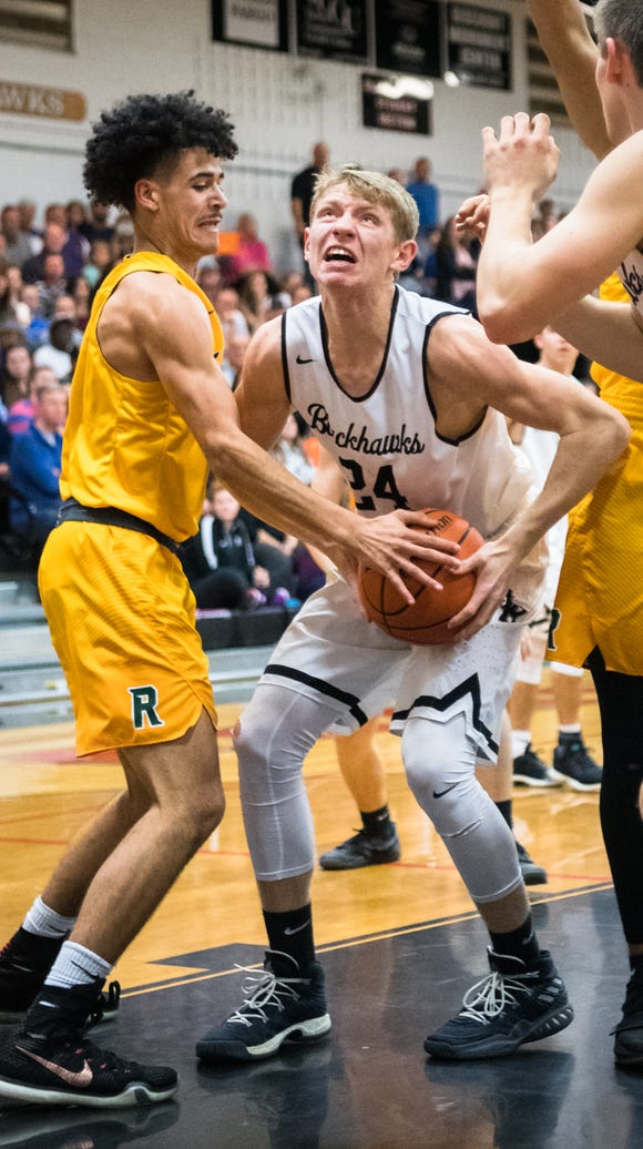 Reynolds' Chase Mease attempts to strip the ball from