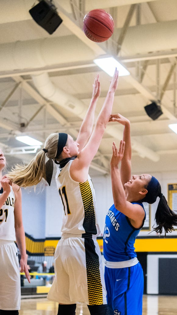 Smoky Mountain's Shay Tisho attempts to make a shot guarded by Tuscola's Gracie Glance during their game in Tuscola's Holiday Classic tournament Thursday, December 28, 2017.