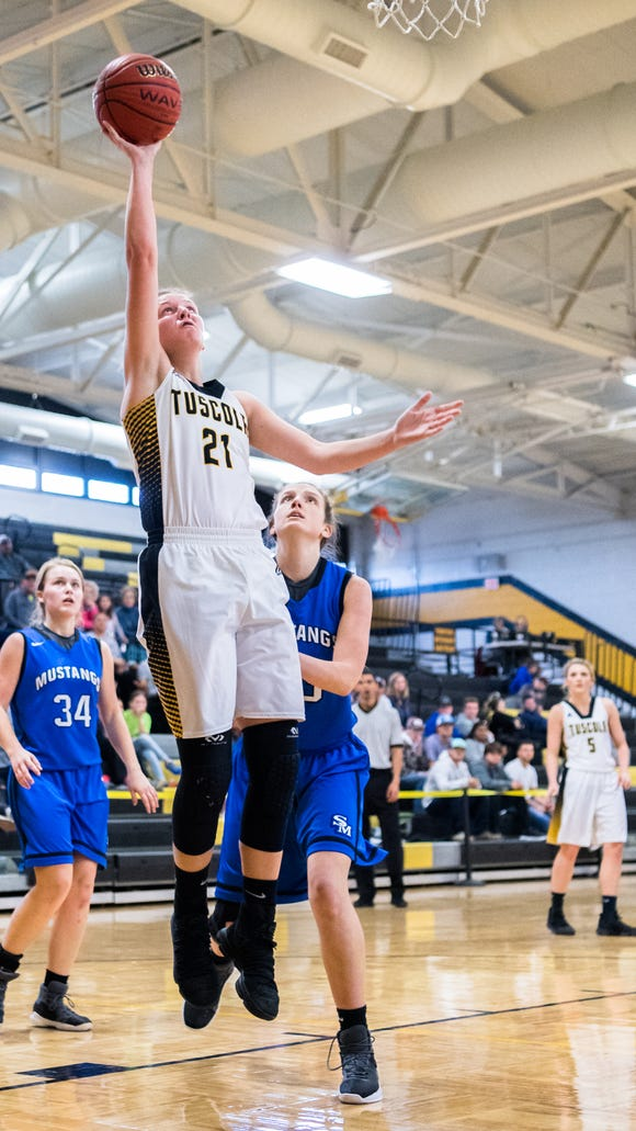 Tuscola's Shelby Glance jumps up for a shot during