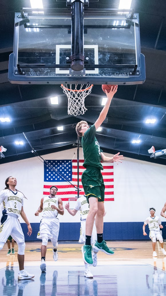 Christ School's Brandon Stone jumps up for a shot during their game against Asheville Christian Academy Tuesday, January 9, 2018.