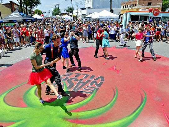 Members of the Nashville Swing Dance Foundation perform during a previous  Tomato Art Festival at Historic East Nashville's Five Points.  The Tomato Art Festival n August features a parade, a costume contest, games and live music.
