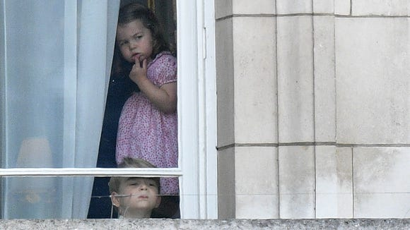 Prince George and Princess Charlotte await the arrival
