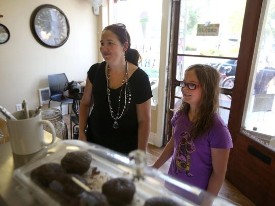 Melanie Ainsworth orders ice cream with her daughter, Cassie, 10, at Main Street Ice Cream Parlor in Monmouth.