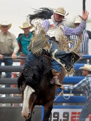 Mike Fred competes in the bareback event during the Big Sky Pro Rodeo at the Montana State Fair.