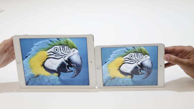 The iPad Air 2, left, and iPad Mini 3 are posed side by side.
