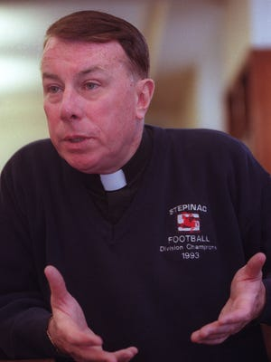 Monsignor John O'Keefe in a file photo from May 12, 2000.