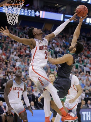 Arizona guard Kobi Simmons (2) blocks a shot by North Dakota guard Quinton Hooker, right, during the first half of a first-round men's college basketball game in the NCAA tournament Thursday, March 16, 2017, in Salt Lake City.