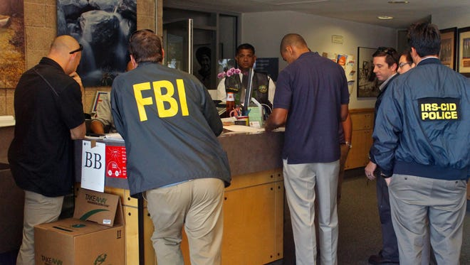 Agents from various law enforcement agencies raid Palm Springs City Hall on Sept. 1.