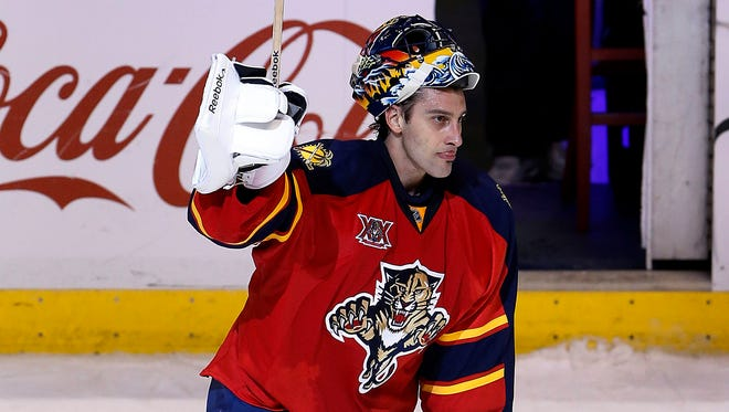 Florida Panthers goalie Roberto Luongo salutes the fans after his shutout against the Buffalo Sabres at BB&T Center.