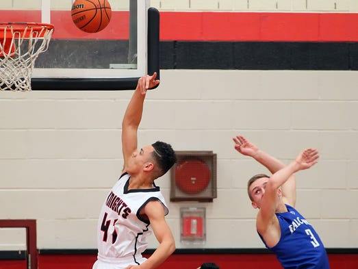 Hempfield's Javon Mitchell (41) goes to the hoop past