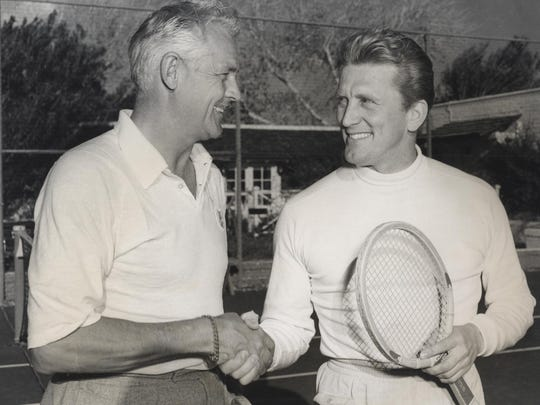 Palm Springs Racquet Club owner Charlie Farrell, left,