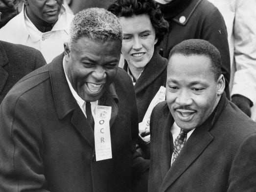 "Jackie Robinson wore an ""Organization for Civil Rights"" badge when he took part in"