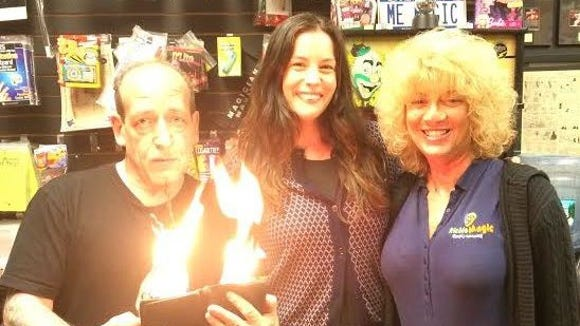 Liv Tyler with Dobs Ferry magic shop owner Richie Magic and his wife Barbara.