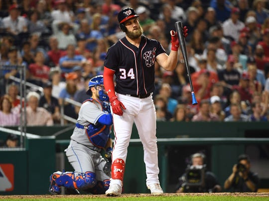 Nationals right fielder Bryce Harper (34) reacts after striking out during the eighth inning against the New York Mets at Nationals Park on Friday, April 28, 2017.