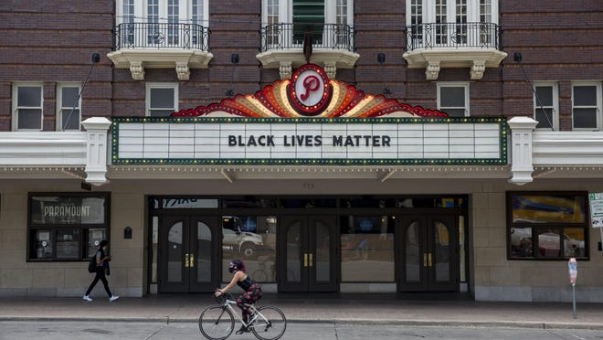 """The marquee on the Paramount Theater reads """"Black Lives Matter"""" on Congress Avenue in Austin on Sunday, May 31, 2020. The message comes as nation-wide protests have emerged against Minneapolis Police Department and the death of George Floyd."""