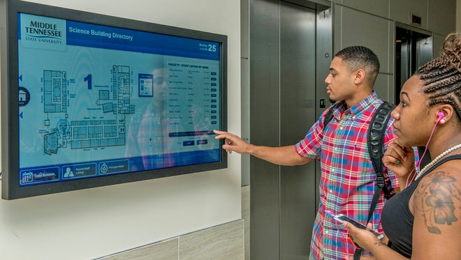 Biology student Eric Wright uses one of the interactive directories to locate a professor's office in the new Science Building at MTSU.