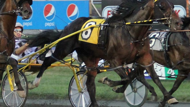 JK Endofanera and Brian Sears, shown winning a Meadowlands Pace elimination race, have won three in a row and will go for four in the Meadowlands Pace on Saturday.