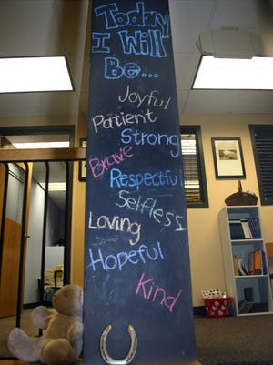 A chalkboard-painted column is displayed at the Resiliency Center of Newtown in Newtown, Conn. Founded after the 2012 Sandy Hook Elementary shootings, the center offers the community mental and emotional health programs that include art, music and play therapy.