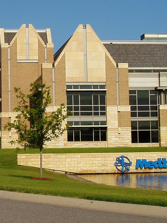 medtronic plans to complete covidien deal