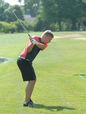 Port Huron's Nick Bailey takes a swing at the Blue Water Junior Golf Tournament  event at Port Huron Golf Club on July 8, 2016.