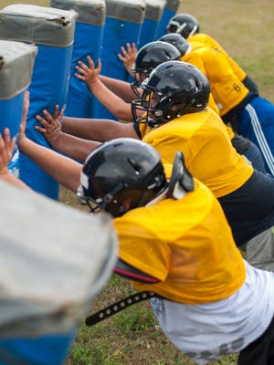 Lineman work on drills Thursday, Aug 11, during football practice at Capac High School.