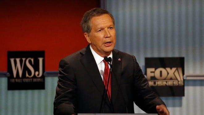 John Kasich speaks during Republican presidential debate at Milwaukee Theatre, Tuesday.