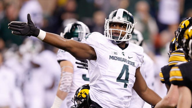 Malik McDowell reacts during the Big Ten Championship against the Iowa Hawkeyes on Dec. 5, 2015, in Indianapolis.