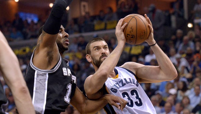 Grizzlies center Marc Gasol, right, drives against Spurs forward LaMarcus Aldridge during the first half of Game 4 on Saturday.