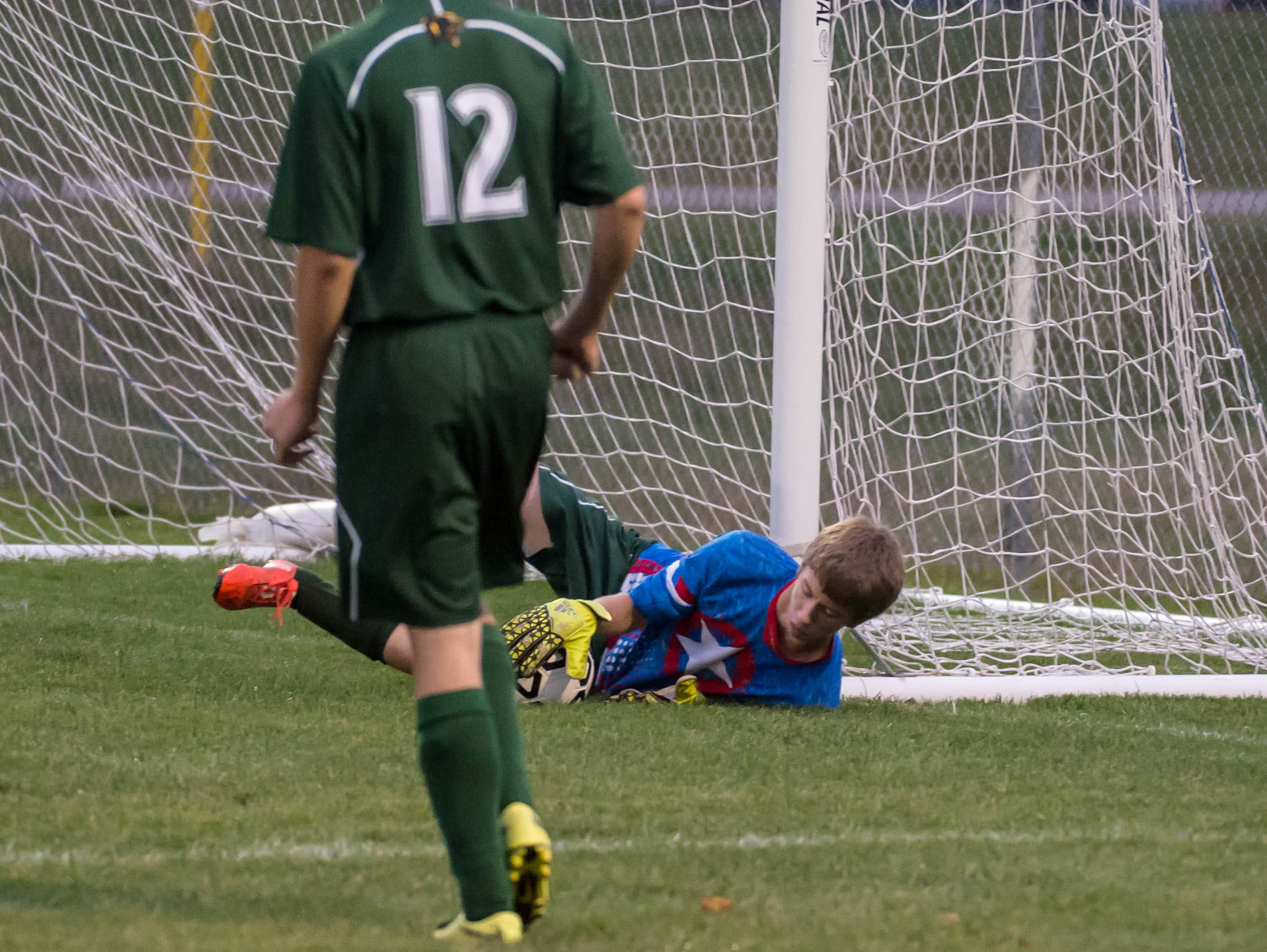 Pennfield's goalkeeper Keith Browand makes a stop during district action Tuesday evening.