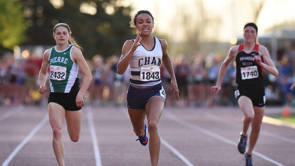 Chanhassen's Jedah Caldwell leads the way in the high school girls 200-meter special event at last year's Howard Wood Dakota Relays.