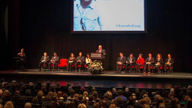 Invited speakers and audience members at a community memorial service for Abdul-Rahman Peter Kassig at Clowes Hall on the Butler University campus Sunday.