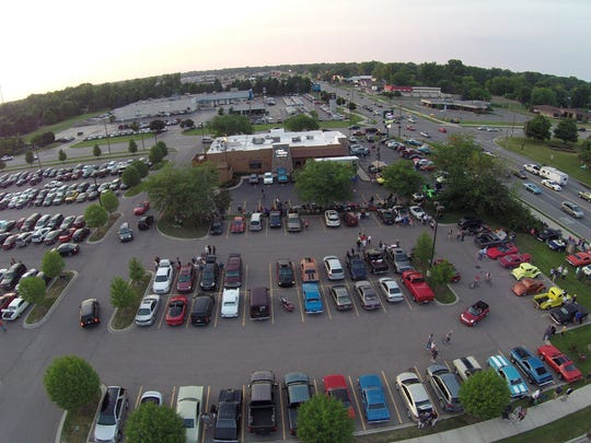 Cruisers parked at Cheap Charlie's on 24th Avenue in Fort Gratiot enjoy music and classic cars during Cruise Night.