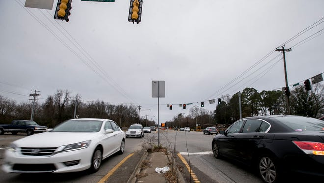 Cars pass by one another at the intersection of Hillsboro Road and Mack Hatcher in Franklin, Tenn., Wednesday, Dec. 21, 2017. The construction project of widening Mack Harcher, which has taken 11 years of planning, will allow the roadway to continue to Highway 96 by cutting into unused land.