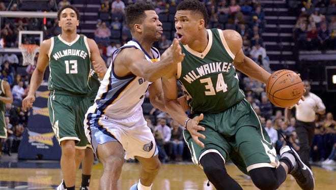 Bucks forward Giannis Antetokounmpo drives against Grizzlies guard Andrew Harrison.