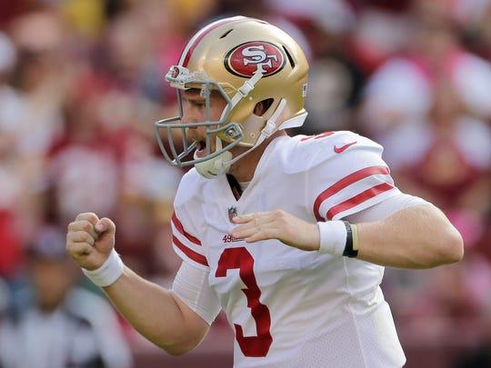 San Francisco 49ers quarterback C.J. Beathard celebrates