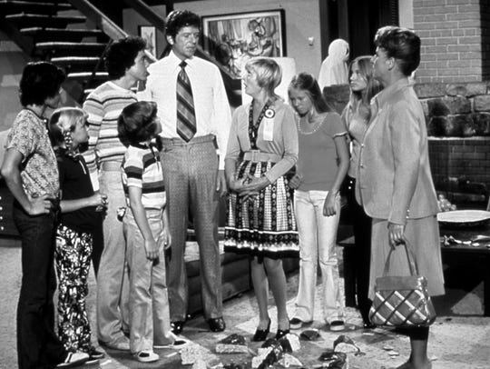 "The cast of ""The Brady Bunch"" inside the interior of"