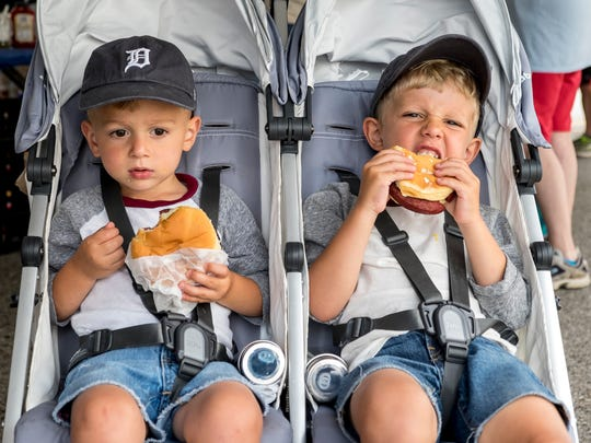 Charlie Allen, 2, left, and his brother Max, 4, eat