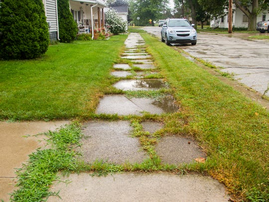 Sidewalks are shown in one Marine City neighborhood. The city is rolling out its sidewalk program, and the residents in the first section of four have been notified they have sidewalks they need to repair or replace.