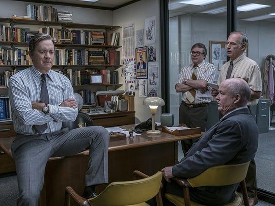 "Tom Hanks,left,  David Cross, Bob Odenkirk, and John Rue in ""The Post."""