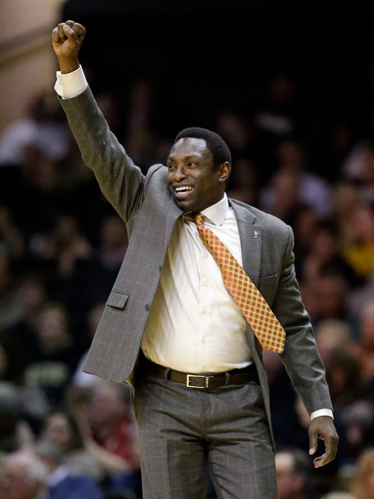 FILE - In this Jan. 16, 2016, file photo, Alabama coach Avery Johnson celebrates after his team scored against Vanderbilt in the first half of an NCAA college basketball game, in Nashville, Tenn. Johnson has been to the NBA Finals as a player and head coach. Now, the former point guard has Alabama's program that hasn't been the NCAA Tournament since 2012 looking like it's poised for a breakthrough. (AP Photo/Mark Humphrey, File)