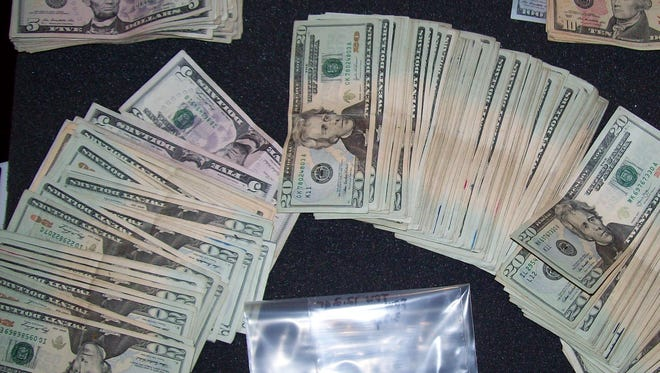 Some of the crack cocaine and money Fort Myers police found at Singleton's apartment.