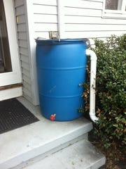 This rain barrel is designed to catch water that flows